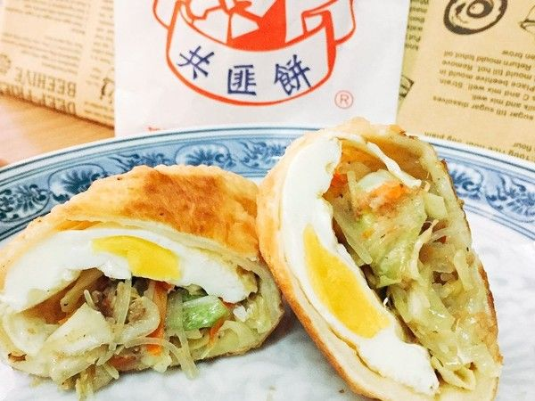 玩咖專欄_7 大台灣街頭美食推薦|嘉義共匪餅引熱議,外皮煙韌鹹甜餡都有